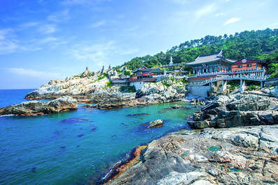 Yonggungsa Temple is perched upon the cliffs overlooking the sea in Busan, South Korea