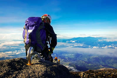 Climbers descending Mount Kinabalu with a stunning view of Malaysian Borneo