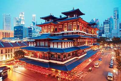 Buddha Tooth Relic Temple in Chinatown with Singapore modern business district as background
