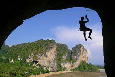 Rock climber with the spectacular cliffs of Krabi as backdrop