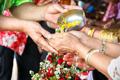 Traditional water pouring ceremony in temples is a peaceful practice