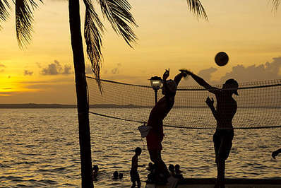 Beach volleyball is a popular sport played throughout tropical Asia