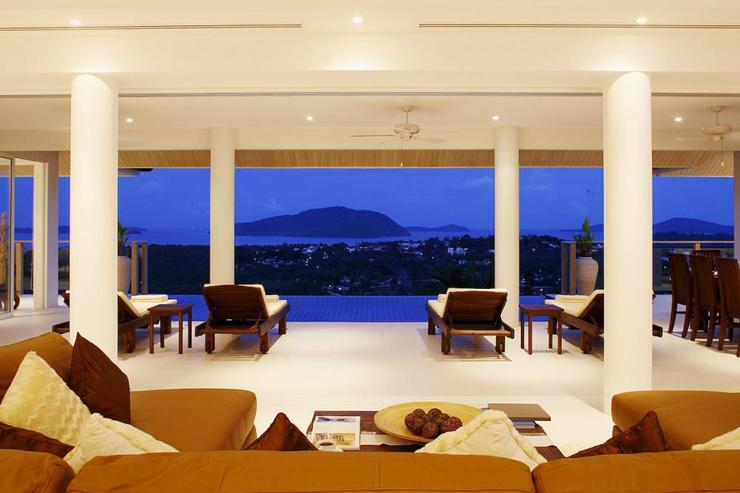 Living room, complete with comfortable leather sofa, to relax and enjoy the views