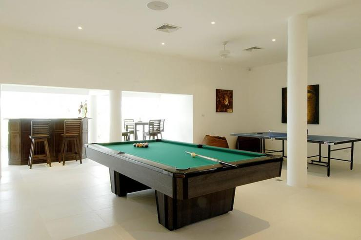 Games room, with pool table, bar area and table tennis table