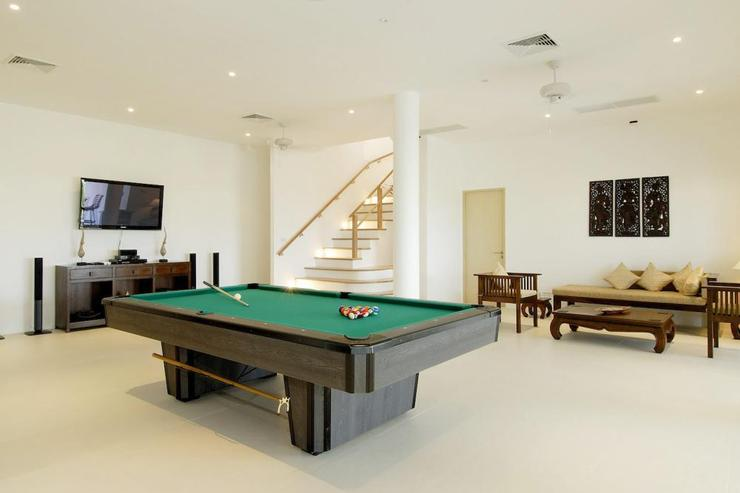 A large TV and seating area complete the games room