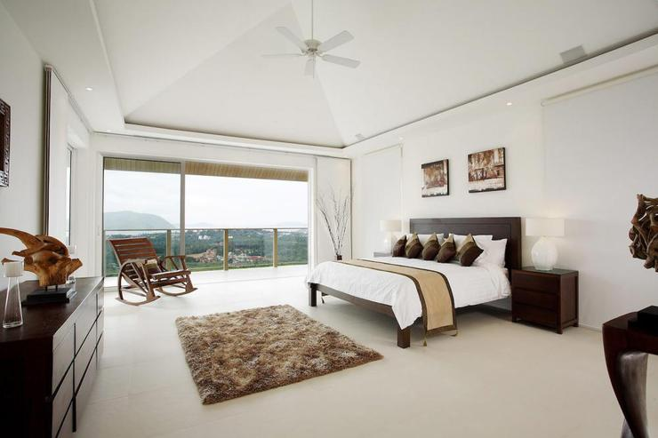Spacious master bedroom with king-size bed and stunning sea views