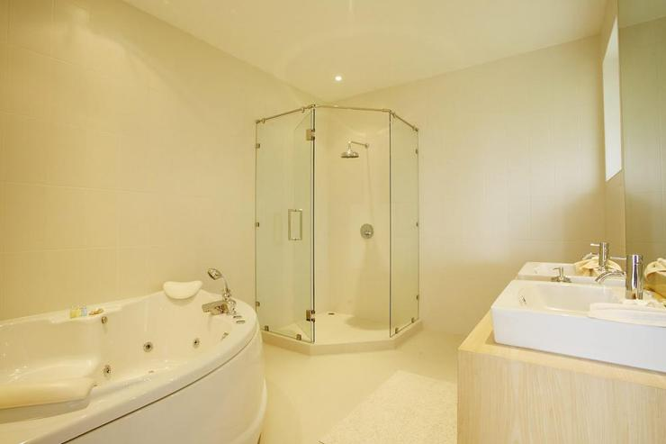 En-suite bathroom for second bedroom, with jacuzzi bath and walk-in shower