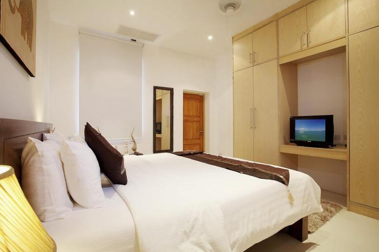 Bedroom 5, complete with TV, air conditioning and ceiling fan