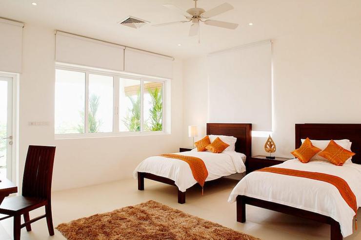 Bedroom 4 with twin single beds and en-suite bathroom