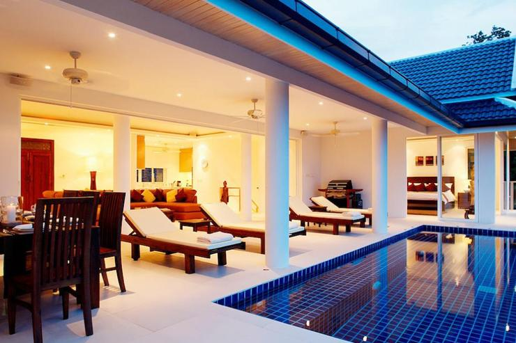 The living room leads directly onto the swimming pool sundeck