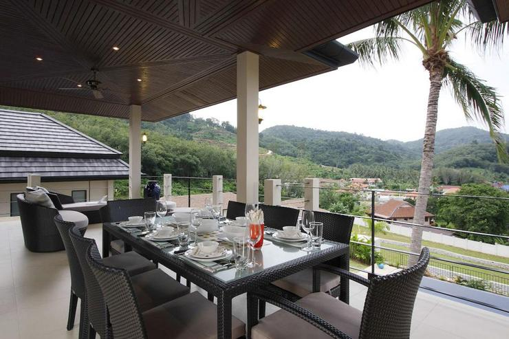 Dining table located on the large outside balcony, perfect for al fresco dining