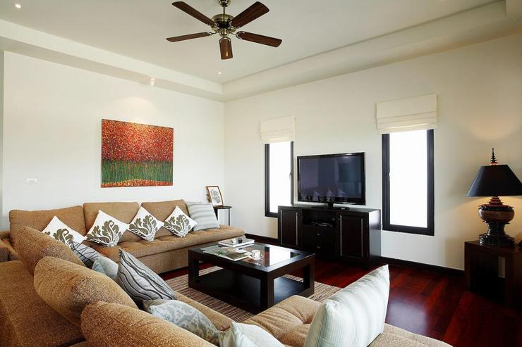 Living room, complete with large sofa, air conditioing and ceiling fans