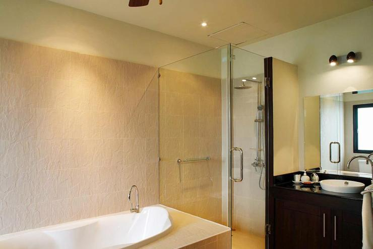 Master bedroom en-suite bathroom, with bath, walk-in shower and twin hand basins
