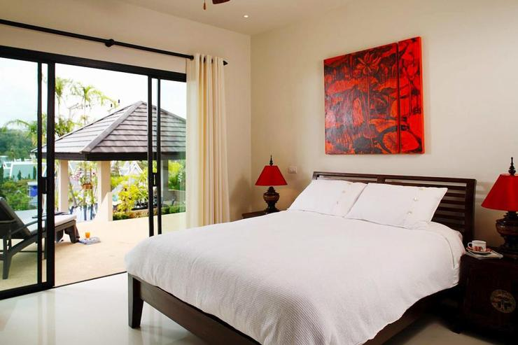 Bedroom 4 with queen-size bed and direct access to swimming pool through sliding doors