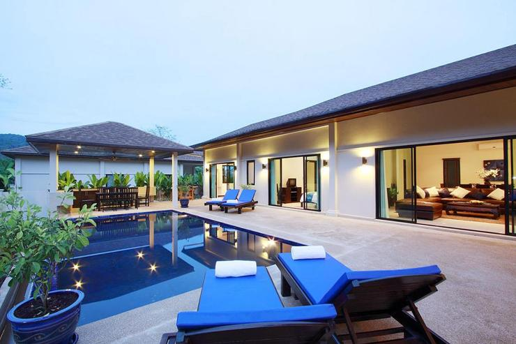 The living room and multiple bedrooms lead directly to the sundeck and swimming pool