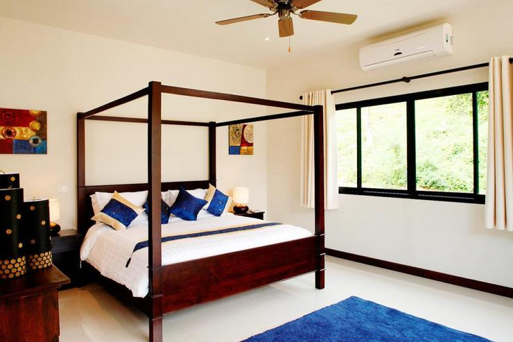 Master bedroom with king-size bed, complete with air conditioning and ceiling fan