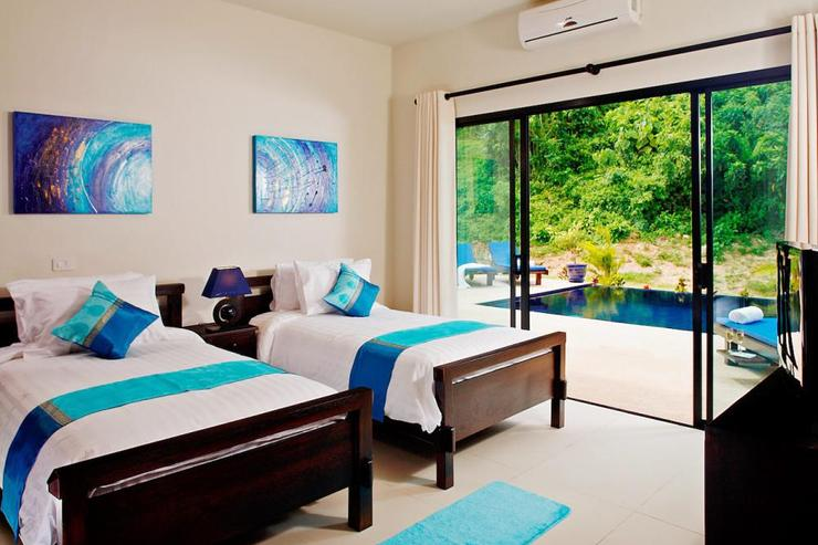 Gemstone Villa (V07) - Bedroom 3, with sliding doors to sundeck and swimming pool.