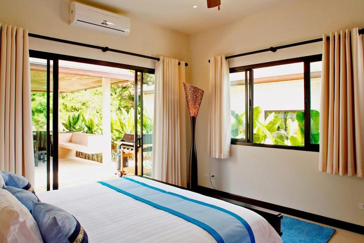 Gemstone Villa (V07) - Bedroom 2 with comfortable king size bed and sliding door to sun deck and swimming pool