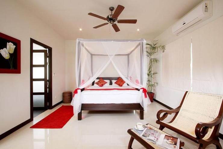 Moonstone Villa (V09) - Master bedroom with king size bed perfect for a tropical retreat