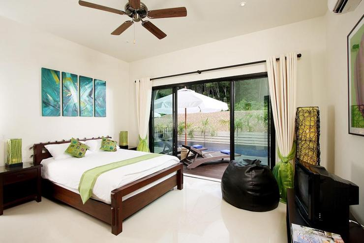 Moonstone Villa (V09) - Bedroom 2 with Queen Size bed, TV, DVD Player and direct access to the swimming pool and sundeck