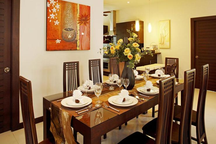 Teak dining table for 8 guests to enjoy delicious in-house prepared Thai cuisine