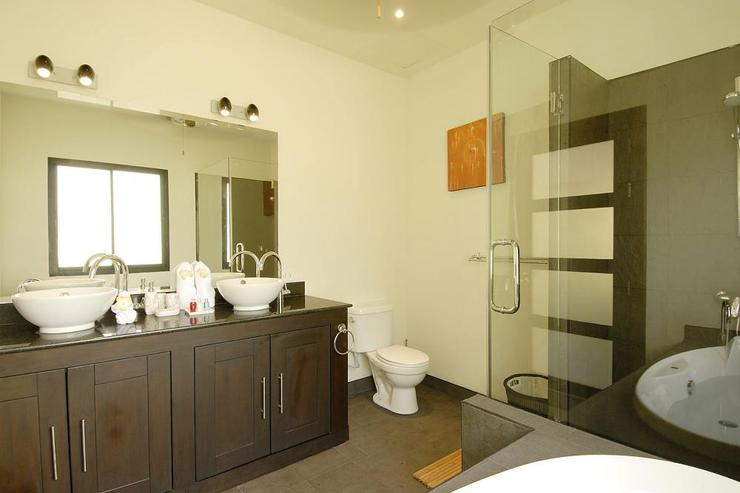 Master bedroom en-suite bathroom, with large bath, walk in shower and twin wash hand basins