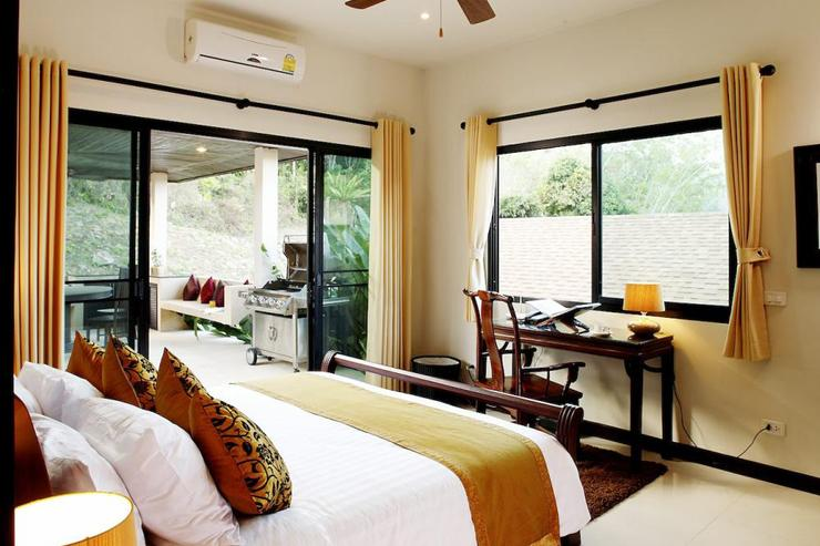 Bedroom 2 with king size bed, and direct access to the sun deck and swimming pool