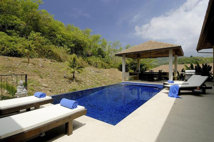 Large private swimming pool, complete with sunbeds on the surrounding sundeck