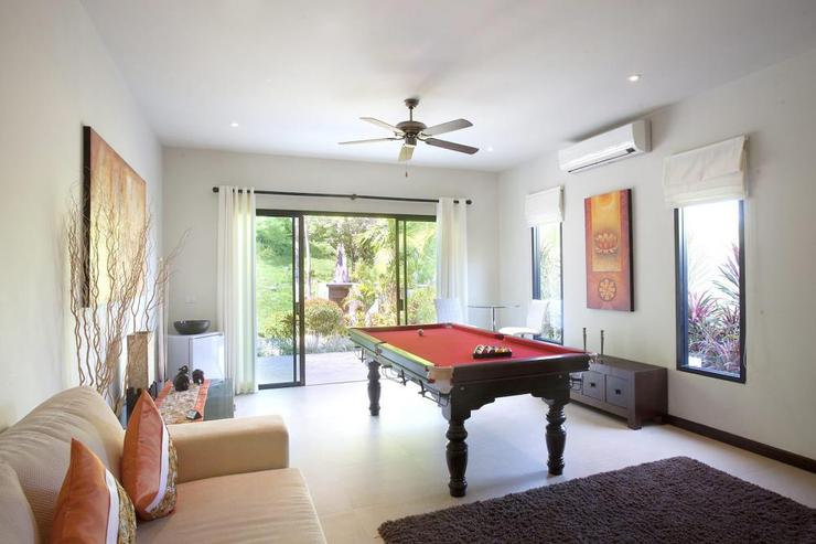 The games room also serves as a second living room with pool table, TV and DVD player