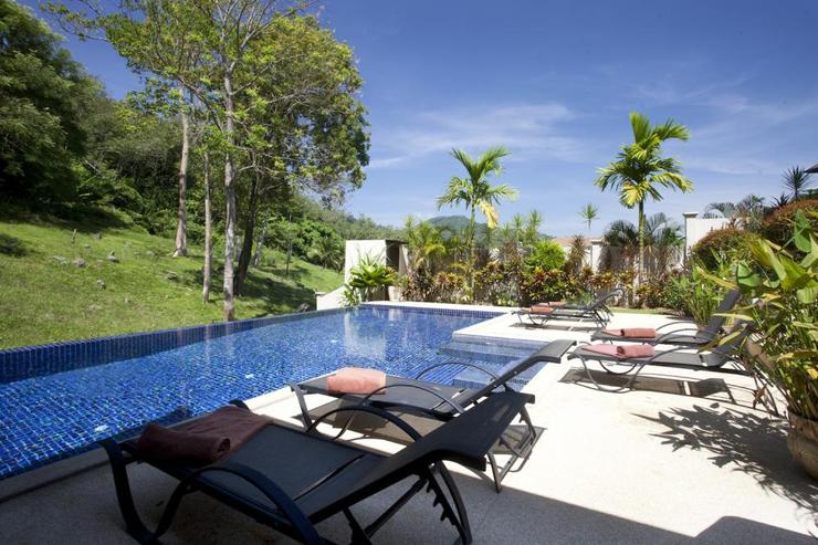 Spacious sundeck surrounding the swimming pool, with ample sunbeds
