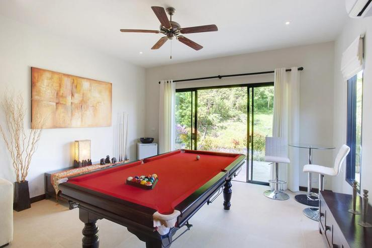 Games room with pool table and direct access to the sundeck and swimming pool