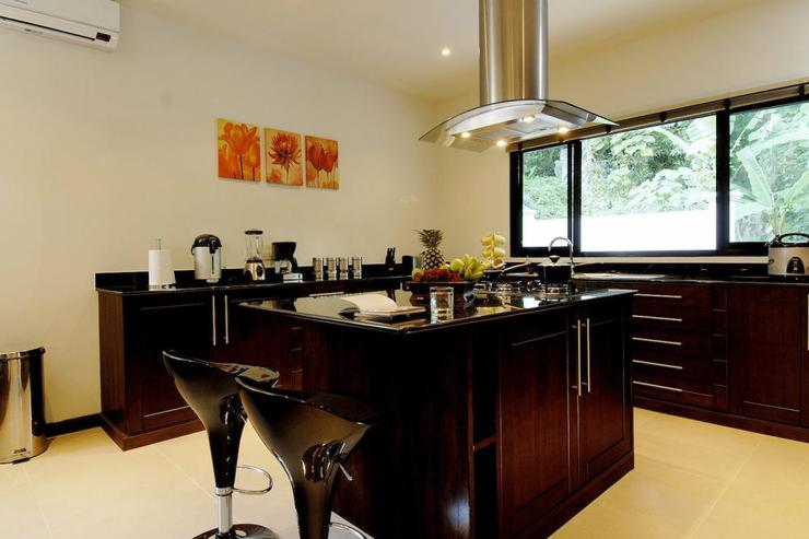 Spacious kitchen, complete with breakfast bar