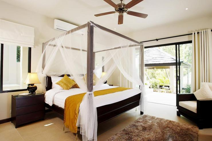 Sunstone Villa (V15) - Bedroom 2 with king-size bed and direct access to sundeck and swimming pool