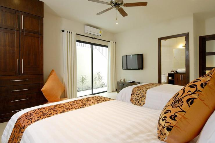 Bedroom 5 with air conditioning, ceiling fan, en-suite bathroom and direct access to the outside
