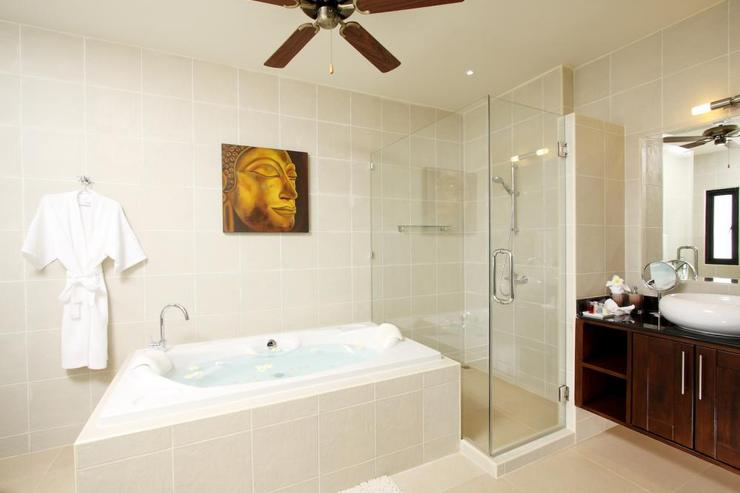 Large master en-suite bathroom with bath, walk-in shower and twin wash hand basins