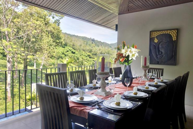 Dining table for 12 guests to enjoy delicious in-house prepared Thai meals