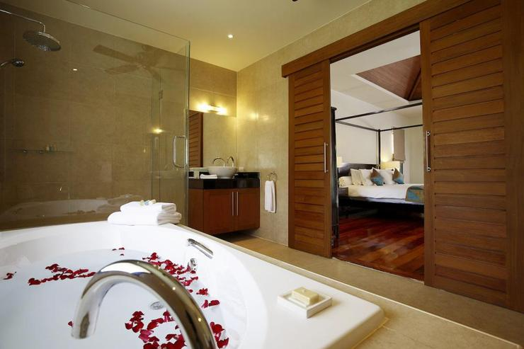 Master bedroom en-suite bathroom with large bath, walk-in shower and two wash hand basins