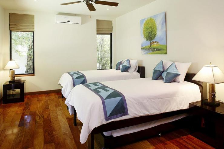 Bedroom 3, located upstairs, with twin single beds and pull-out single trundle beds below, as well as en-suite bathroom, air conditioning and ceiling fan