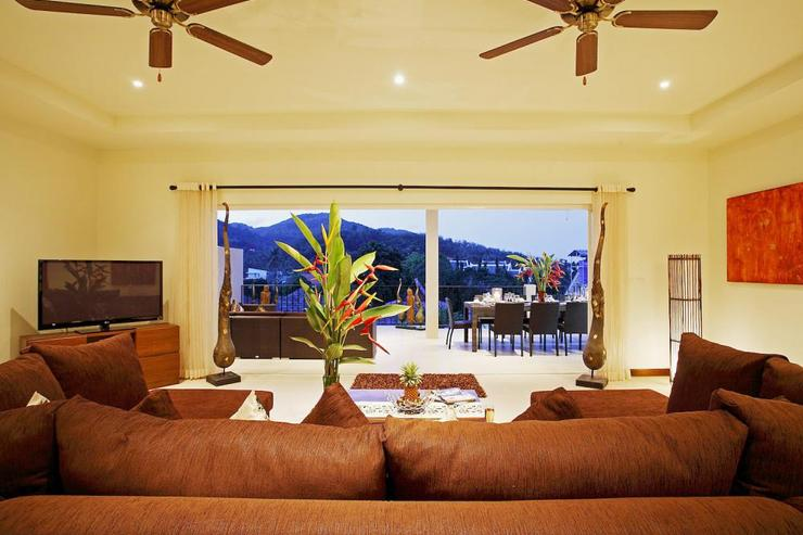 Amber villa (V01) - Comfortable living room leads onto balcony, with views across the valley
