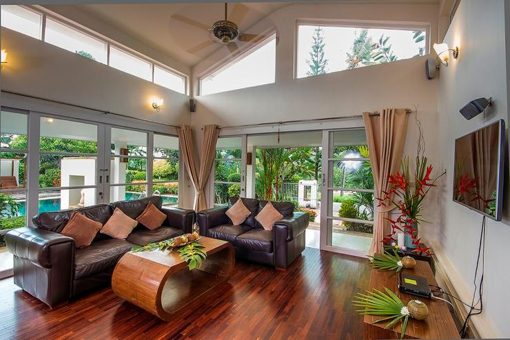 Take a break from outdoors at this cozy lounge area with leather sofas and flat screen TV