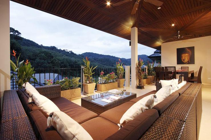 Covered balcony with soft seating area and dining tabe