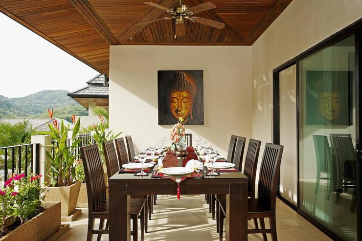 Undercover dining table seating 12 guests, perfect for enjoying in-house Thai meals prepared upon request