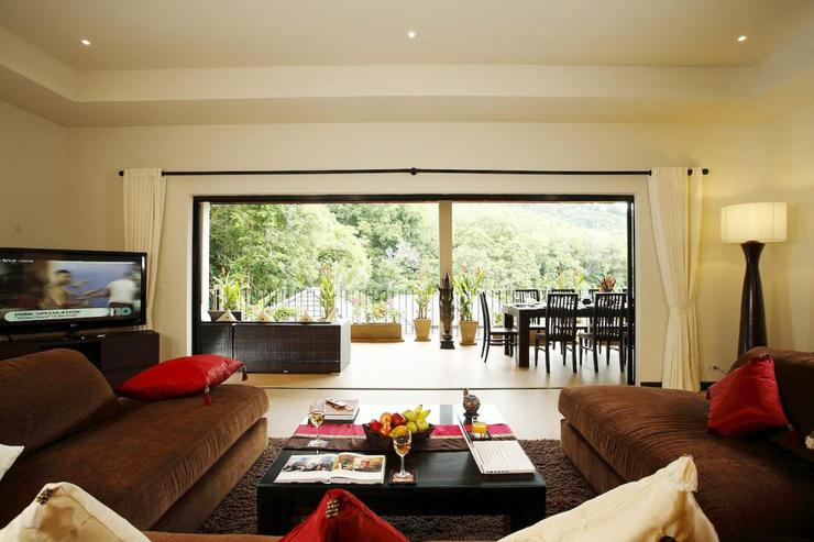 Spacious living room with sliding doors to covered balcony, ideal for indoor/outdoor living