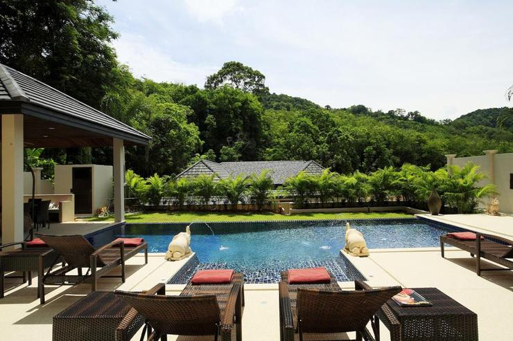 The sundeck offers a tranquil setting with views of the hillside