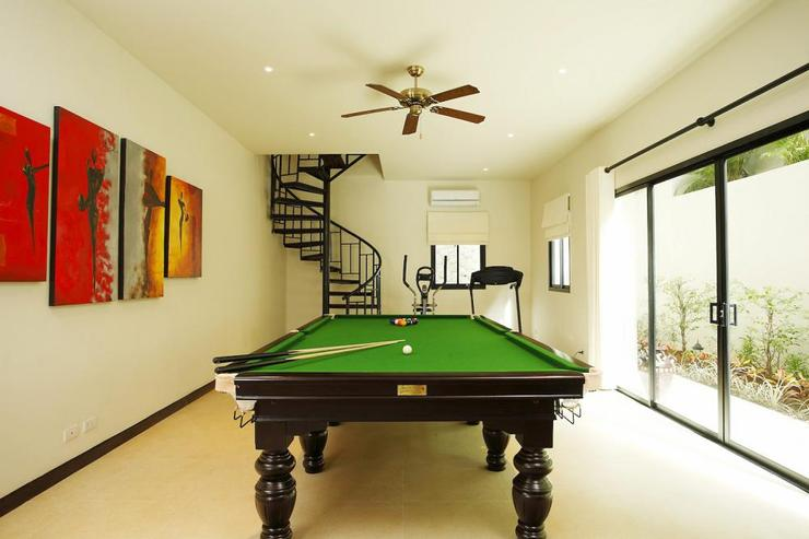 Large games room, with pool table, dart board and gym equipment