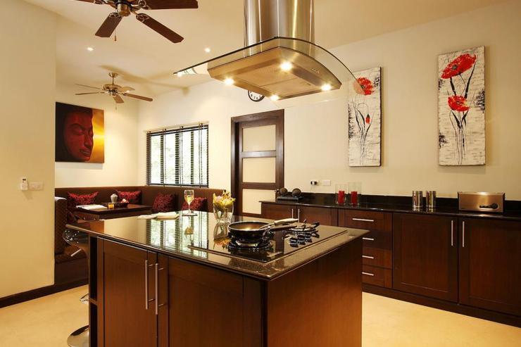 Spacious Western-style kitchen, adjacent to Thai sitting area