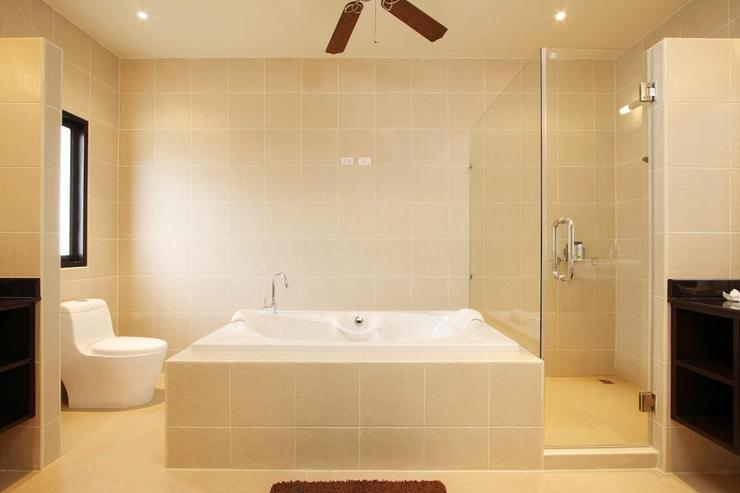 Master bedroom en-suite bathroom, with large bath, walk-in shower and two hand basins