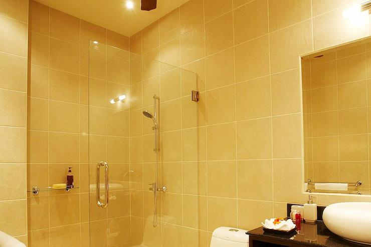 Bedroom 4 en-suite bathroom with large walk in shower