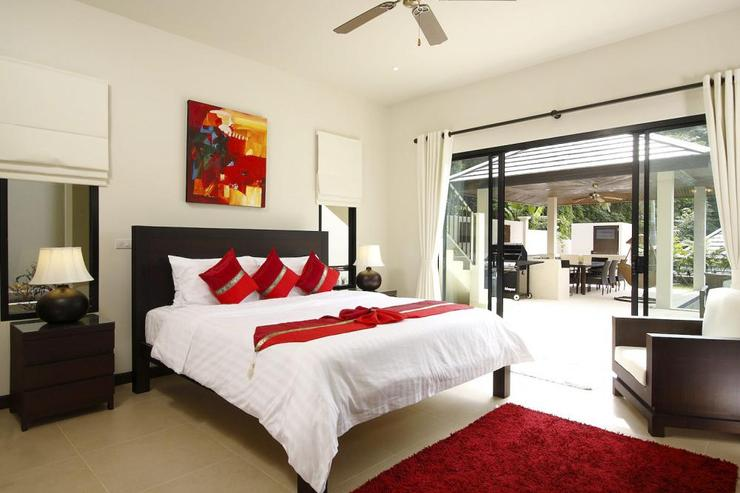 Bedroom 3, on lower level, with king-size bed and sliding doors to sun deck and swimming pool
