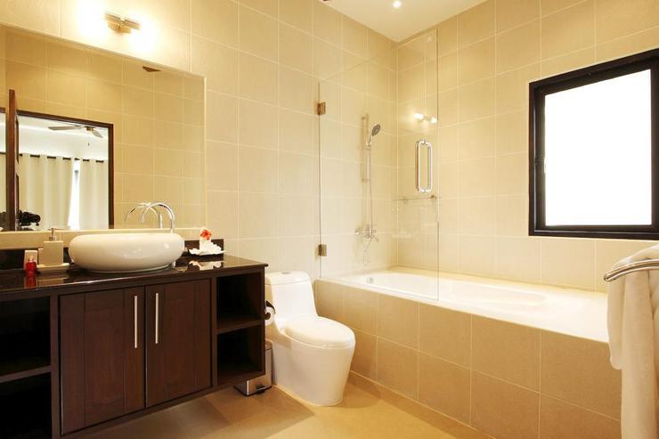 Bedroom 3 en-suite bathroom with bath, shower and vanity unit
